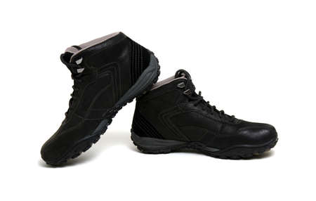 Black mans boots isolated on a white background.