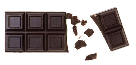 Broken chocolate bar isolated on white. Top view