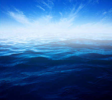 Blue sea water surface on sky Banque d'images