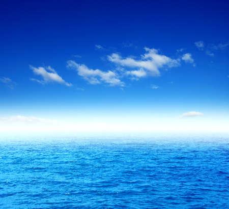 Blue sea water surface on sky Stock fotó