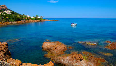 Beautiful summertime panoramic seascape. View of the cliff into the crystal clear azure sea .Ship yachts on the horizon.