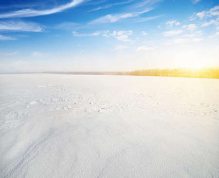 Winter landscape. Snowcovered fields on  sky and sun. 写真素材