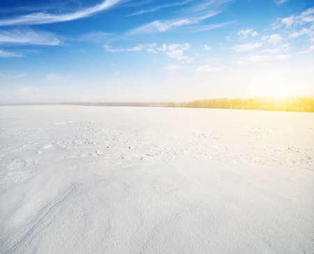 Winter landscape. Snowcovered fields on  sky and sun. 版權商用圖片