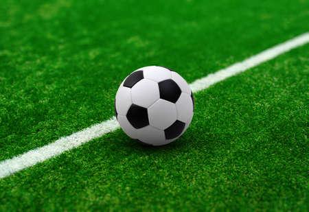 Balón de fútbol en el campo de fútbol
