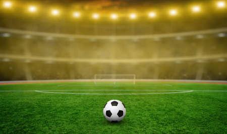Soccer ball on green stadium, arena in night illuminated bright spotlights Banque d'images - 120345154