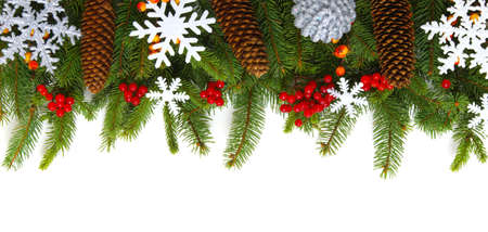 Christmas background with fir tree and decoration on white Imagens