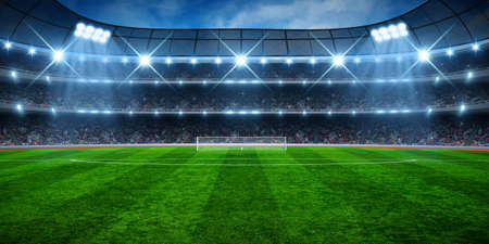 Green soccer stadium, illuminated field, arena in night Stock Photo
