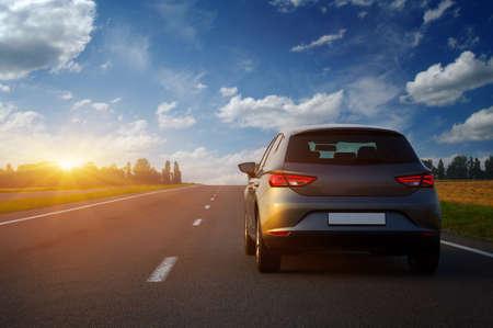 Car on asphalt road in summer