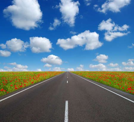 Asphalt car road and clouds on blue sky in summer day Stock fotó