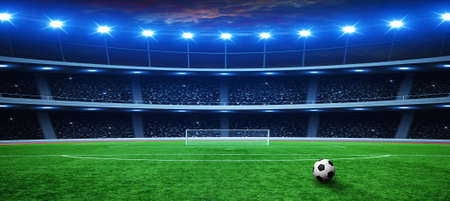 Soccer ball on green stadium, arena in night illuminated bright spotlights Archivio Fotografico