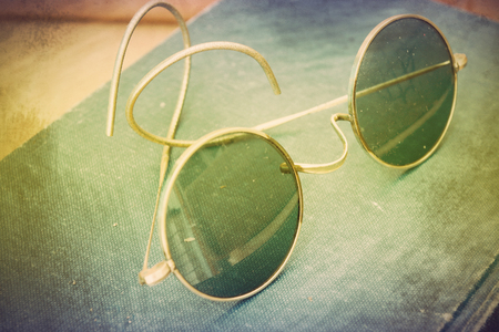 Vintage photo with old John Lennon glasses