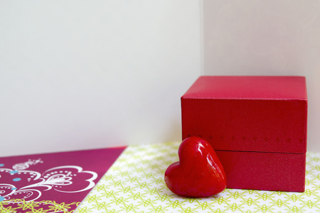 felicitation: Little red box and a heart with greeting cards Stock Photo