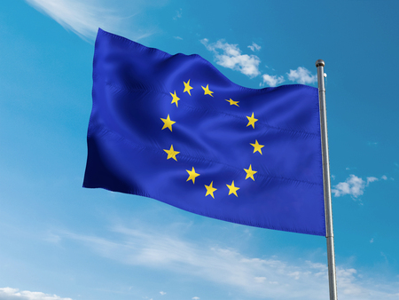 European Union flag waving in blue sky Stock Photo
