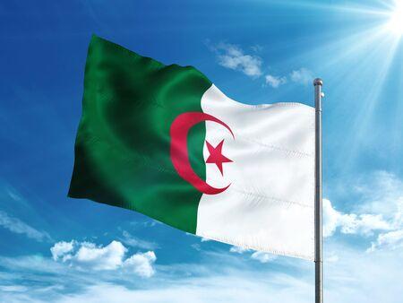 Algeria flag waving in the blue sky