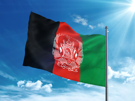 Afghanistan flag waving in the blue sky
