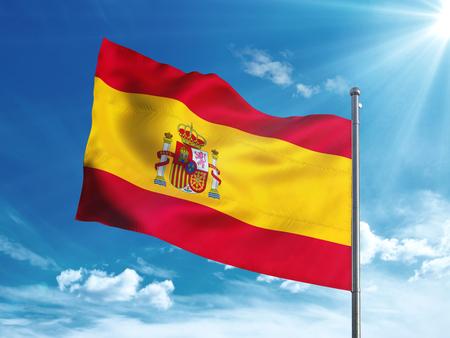 Spain flag waving in the blue sky