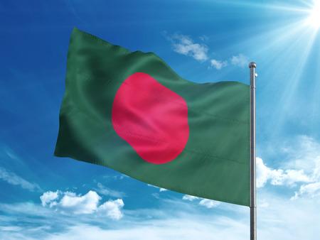 Bangladesh flag waving in the blue sky