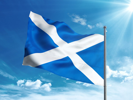 Scotland flag waving in the blue sky Stock Photo