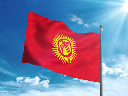 Kyrgyzstan flag waving in the blue sky