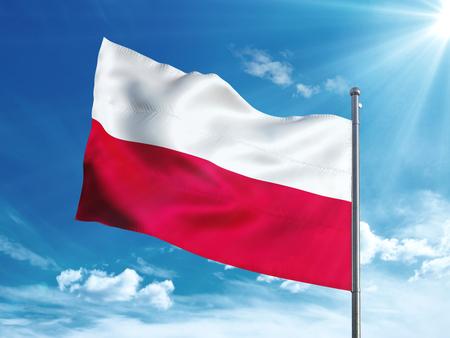 Poland flag waving in the blue sky
