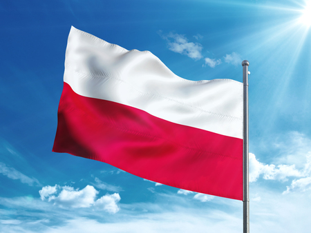 Poland flag waving in the blue sky