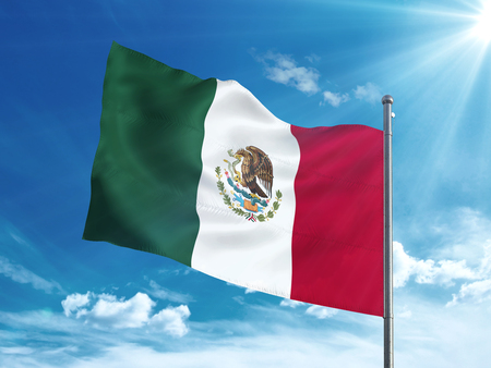 Mexico flag waving in the blue sky