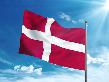 Denmark flag waving in the blue sky