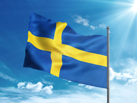 Sweden flag waving in the blue sky