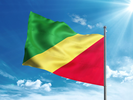 Republic of the Congo flag waving in the blue sky