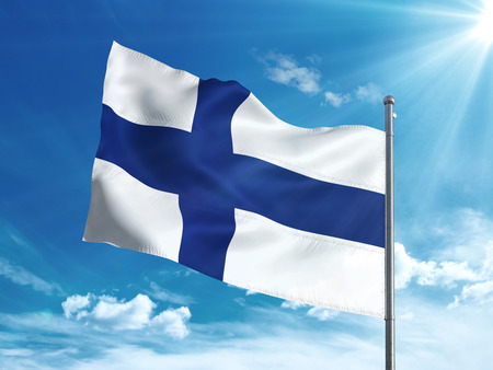 Finland flag waving in the blue sky