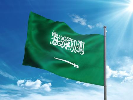 Saudi Arabia flag waving in the blue sky