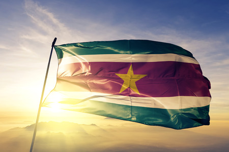 Suriname flag textile cloth waving Stockfoto