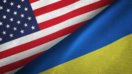 United States and Ukraine two flags textile cloth, fabric texture