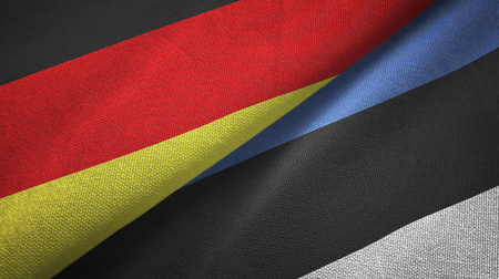 Germany and Estonia flags together relations textile cloth, fabric texture Фото со стока