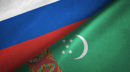 Russia and Turkmenistan flags together relations textile cloth, fabric texture Stock Photo