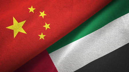 China and United Arab Emirates flags together relations textile cloth, fabric texture Stock Photo