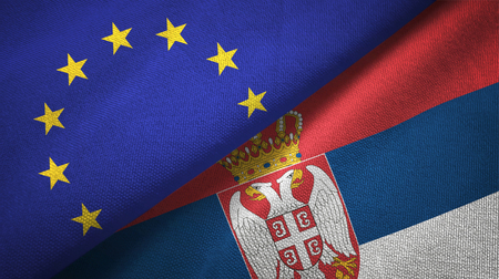 European Union and Serbia flags together relations textile cloth, fabric texture Stock Photo