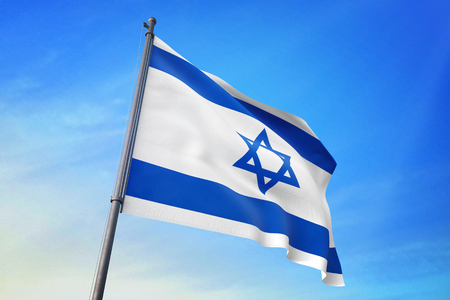 Israel flag waving against blue sky Stock Photo