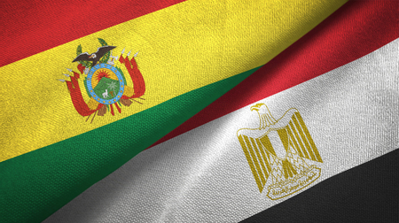 Bolivia and Egypt flags together relations textile cloth, fabric texture. Text on egyptian flag means - Arab Republic of Egypt Foto de archivo