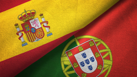 Spain and Portugal flags together relations textile cloth, fabric texture Stock Photo