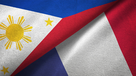 Philippines and France flags together relations textile cloth, fabric texture Stock Photo