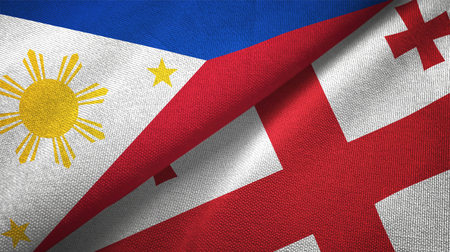 Philippines and Georgia flags together relations textile cloth, fabric texture Stock Photo