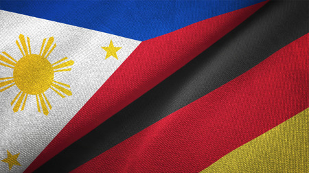 Philippines and Germany flags together relations textile cloth, fabric texture Stock Photo