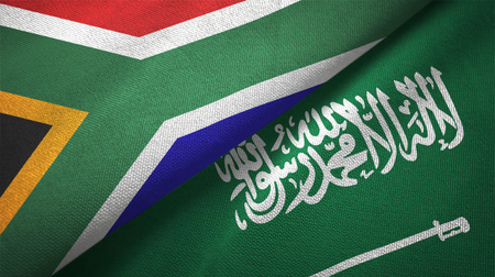 South Africa and Saudi Arabia flags textile cloth, fabric texture. Text on saudi arabian flag means - There is no god but God, Muhammad is the Messenger of God