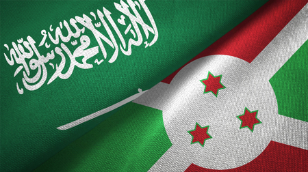 Saudi Arabia and Burundi flags. Text on saudi arabian flag means - There is no god but God, Muhammad is the Messenger of God Foto de archivo
