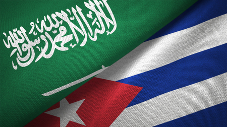 Saudi Arabia and Cuba flags. Text on saudi arabian flag means - There is no god but God, Muhammad is the Messenger of God