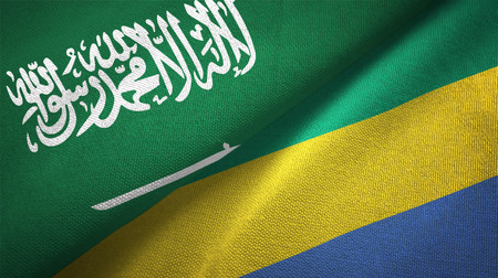 Saudi Arabia and Gabon flags. Text on saudi arabian flag means - There is no god but God, Muhammad is the Messenger of God