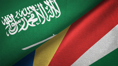 Saudi Arabia and Seychelles flags. Text on saudi arabian flag means - There is no god but God, Muhammad is the Messenger of God
