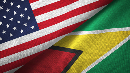 United States and Guyana two folded flags together