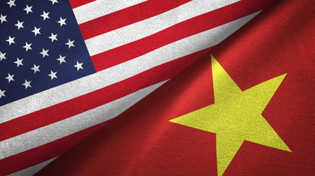 United States and Vietnam two folded flags together Фото со стока